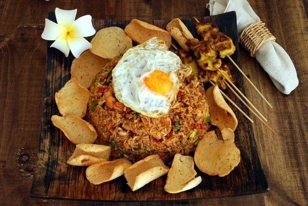 Nasi Goreng   30 Delicious Indonesian Dishes You Need To Try Can you get through this post without drooling all over your keyboard?  Via BuzzFeed