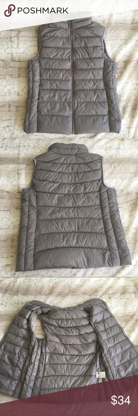 """Uniqlo Lightweight Vest Soft, lightweight, and versatile color. Down-blend filling. Great condition but does have some staining on the front. It's so unnoticeable and difficult to photograph. Approximate Measurements: 20"""" across the chest, 15"""" across the shoulders, and 25"""" long. Bundle to Save! 3+items=30% off! No trades or lowballs. Uniqlo Jackets & Coats Vests"""