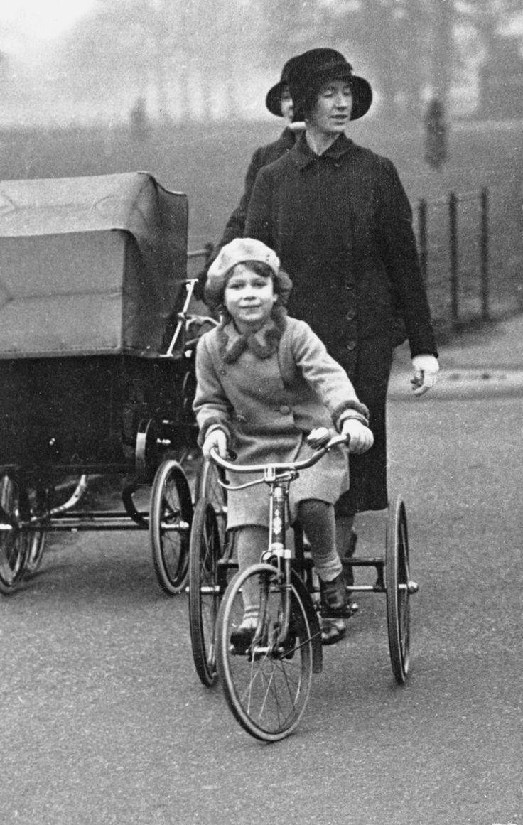 Queen Elizabeth riding a bike.