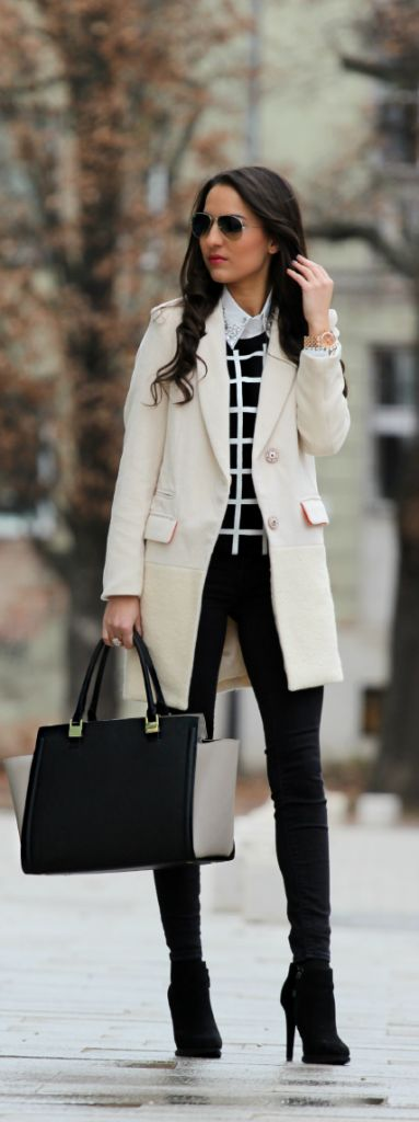 Loving this black & white street style fashion. Oh and the white over-coat we can't get enough of. This street style look is classy & simply flawless.