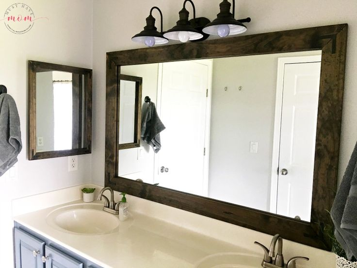 DIY vanity mirrors! Farmhouse style bathroom vanity mirror and medicine cabinet upgrade with step by step tutorial!
