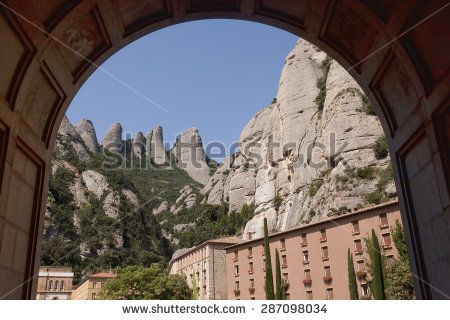 The buildings of the monastery of Montserrat. View through the arch of the Basilica