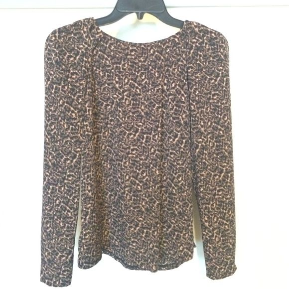 "Tahari A.S.L. ""Hermetta"" Animal Print Blouse Tahari A.S.L. ""Hermetta"" Animal Print Blouse. Only worn once and dry cleansed since. Comes with extra button. Side zipper. Tahari Tops"