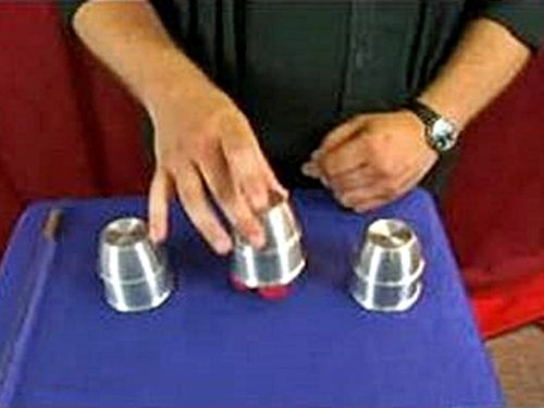 Ball under a cup sleight of hand technique.  http://www.magictricksreviewed.com/learn-sleight-of-hand-techniques-magic-tricks/  #sleight of hand #magic tricks