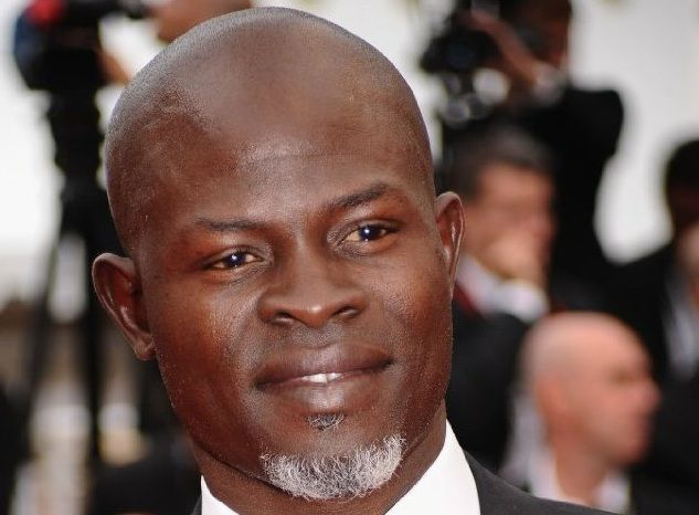 "Djimon Hounsou is an American actor and model, who owns a net worth of $10 million. Hounsou earned his net worth through some popular movies, like ""Without You I Am Nothing"", ""Amistad"", and ""In America"". Born in Benin, Djimon appeared as a model for the brand Calvin Klein."