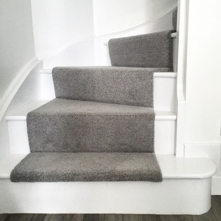 Clean and minimal staircase with grey runner.