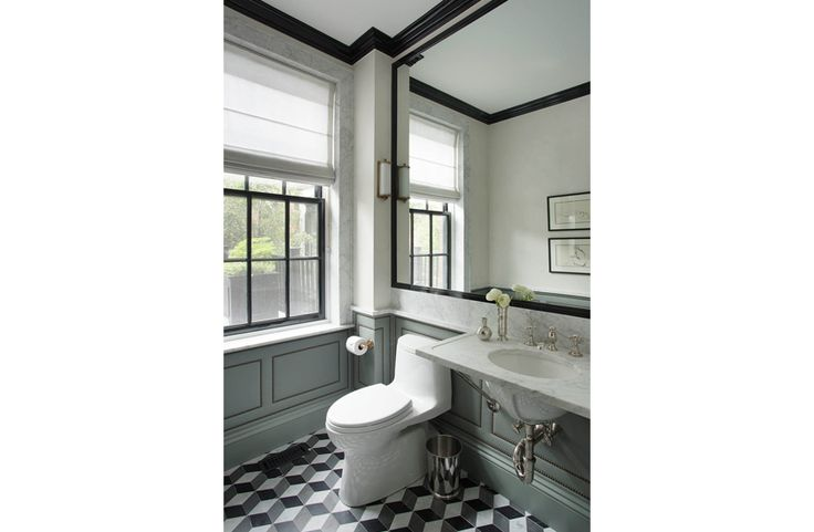 Fired Earth floor tiles, good colour on the panelling, white metro tiles, black accents...
