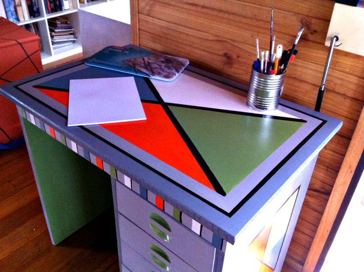 Functional Furniture-Art:  I love old vintage furniture and love painting it bright modern funky colours. This is my latest painted furniture design.  For this little desk I decided to paint it in colours to suit a possible boys room. The top caused a few problems but eventually I got there. I sold it on eBay under Bronwen5518.