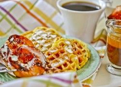 Waffles with Honey-Caramelized Peaches & Crème Fraiche:  2 multigrain waffles   Honey-caramelized peaches:  1/3 cup honey  1/4 tsp. ground cinnamon  1/8 tsp. ground ginger  1 cup hot water  4 Tbs. (1/2 stick) unsalted butter  5 ripe peaches, halved and pitted  2 tsp. fresh lemon juice