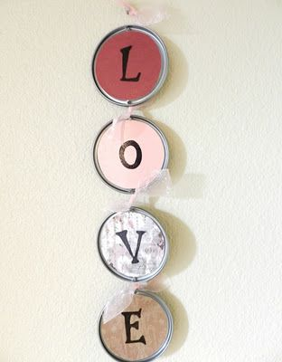 Valentine's Day Love Sign  Turn recycled juice can lids into pretty wall decorations for Valentine's Day