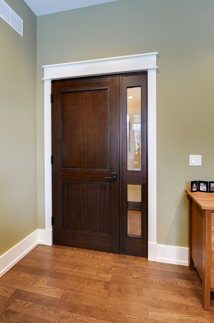 custom solid wood door with sidelite for the home office crafted by doors for builders