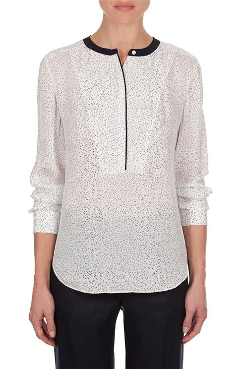 Silk Print Shirt This pure silk shirt adds effortless elegance to your wardrobe. Colour block trims accent the mini texture print. Featuring a concealed front placket, subtle stitched bib detail at front, shell buttons and curved hems.