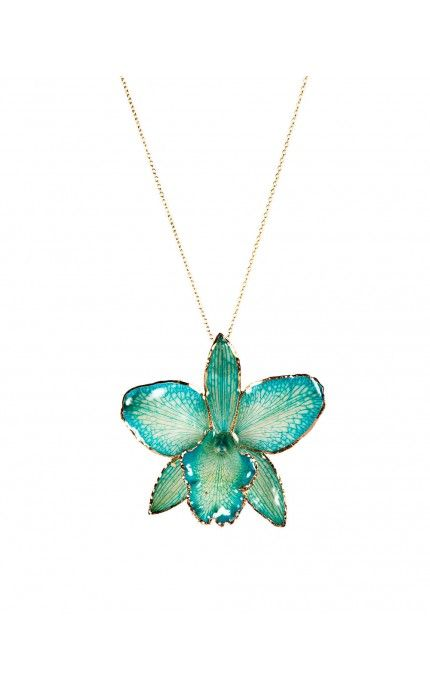 """Orchid Necklace in Turquoise: This striking necklace is made using a real orchid encapsulated in resin to preserve its delicate beauty & finished off with gold edging and suspended from an 18"""" chain -"""