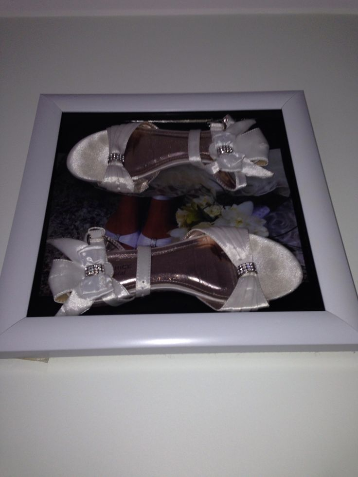 Wedding shoes displayed in shadow box