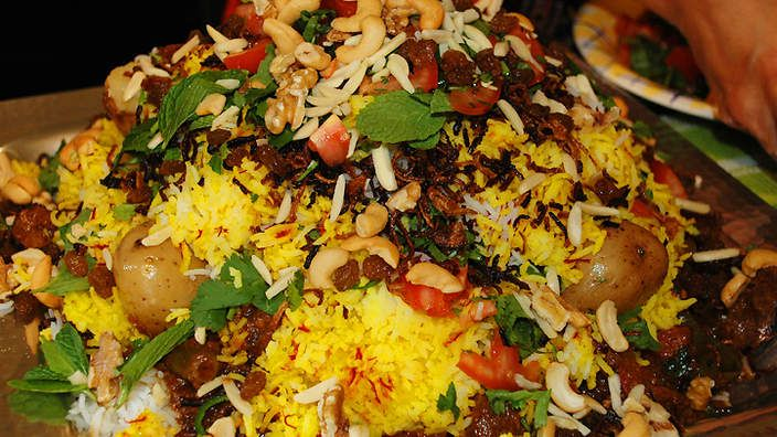 Sindhi biryani   This recipe for biryani is a marvellous creation of layers of perfectly cooked goat curry, beautiful rice and a fresh mix of tomato, herbs and chilli, all decorated with nuts and onion rings. This is a feast in its own right, but Sonya likes to serve it with a chopped salad, called a cachumbar, containing tomato, red onion, lettuce and vinegar, and with a yoghurt raita containing mint and cumin.
