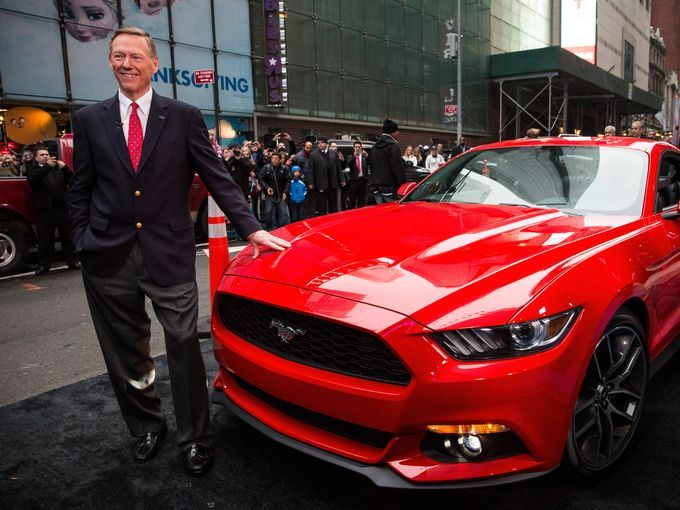 Alan Mulally, CEO of Ford, poses next to the 2015 Ford Mustang on the set of Good Morning America in New York City