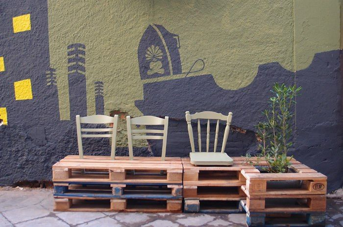 Upcycled pallet benches with old chair seats and plants. Public space in Athens, by Atenista