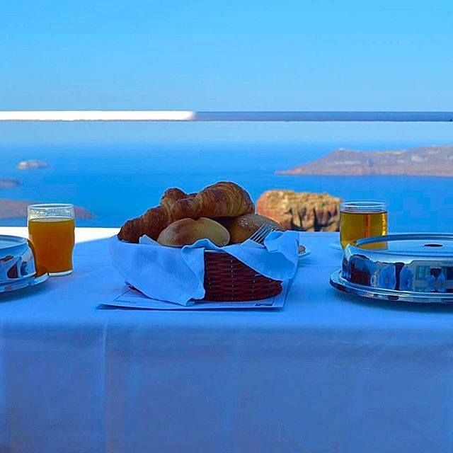 """""""Now this is how breakfast should be served! Thanks @Astra suites for providing this superb view with some of the best croissants we have ever had!""""   Thank you Bktravelcorner @Instagram for sharing your Astra breakfast experience with the world!  #breakfast #view #sea #sun #santorini #island #blue #sky #food #croissant #villas #island #santorini"""