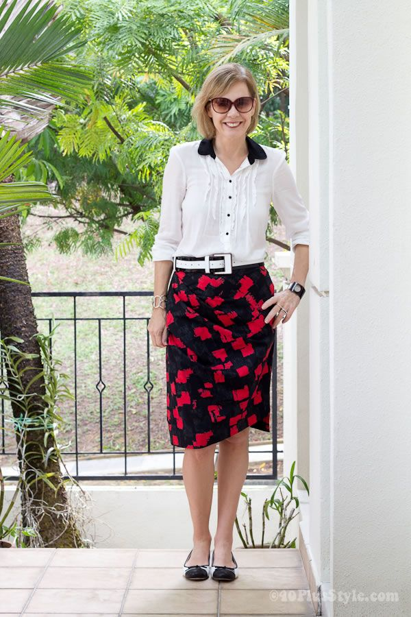 black and white blouse with red printed skirt