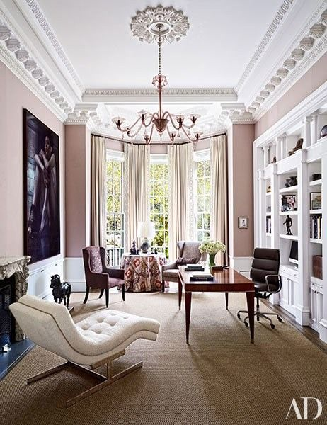 A Martin Eder photograph presides over the study of a Boston townhouse decorated by Wells & Fox; the 1930s Venini chandelier is from Doris Leslie Blau, the vintage chaise longue is a Milo Baughman design for Thayer Coggin, and the leather-bound sisal is by Stark | archdigest.com