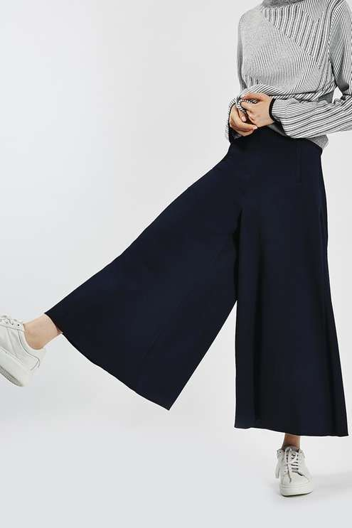 Work the season's must-have wide leg silhouette in these chic palazzo trousers. Sitting high on the waist, they are crafted in a sleek black hue and come finished with practical welt pockets. We love them styled back with a patterned shirt and cool trainers. #Topshop