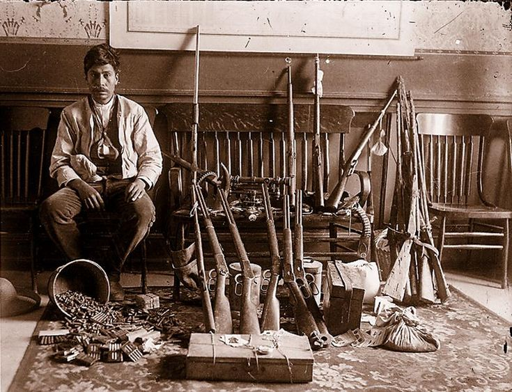 """RevolutionistThe abundance of 1892 and 1894 Winchester rifles in the array of weapons and ammunition next to this Revolutionist vaquero explains the popularity of the Mexican Revolution folk song, """"Carabina Treinta Treinta,"""" about the .30-30 carbine.– Courtesy Garry James Collection —"""