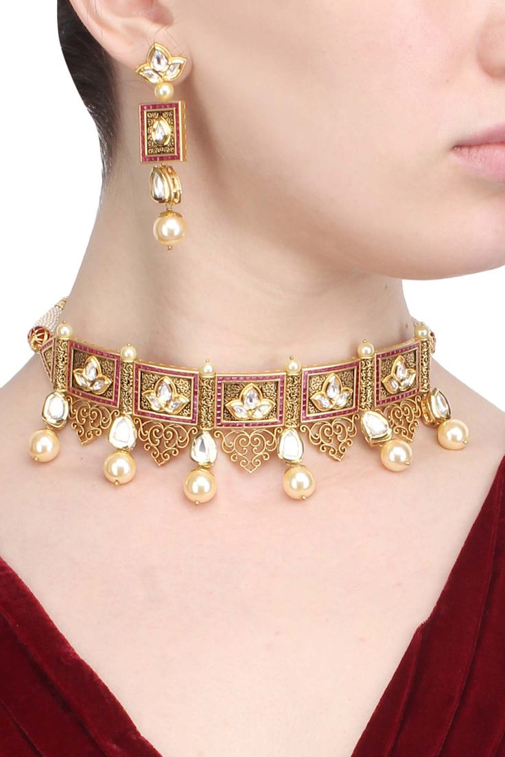Antique gold finish textured polki and ruby choker with polki flower earrings available only at Pernia's Pop Up Shop.