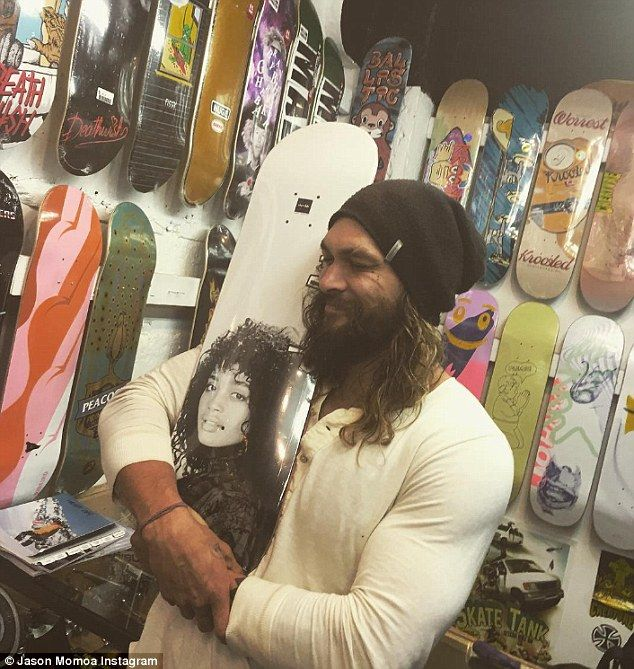 Big softy: Jason Momoa plays a tough guy in movies, but in real life, he's a sweetheart as he showed when he shared this shot of himself hugging a skateboard with a vintage photo of his wife, Lisa Bonet's, face emblazoned on it