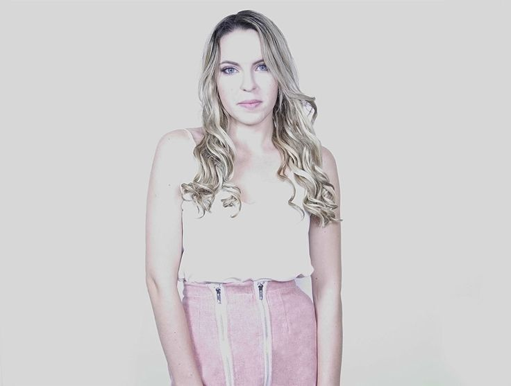 Smiling Platinum Blonde Girl in a Handmade Genuine Pink Wool Pencil Skirt with two white front zippers made in Toronto with love 💕  Chic Sophistic™ http://chicsophisticstore.com/product/chic-pink-wool-skirt/