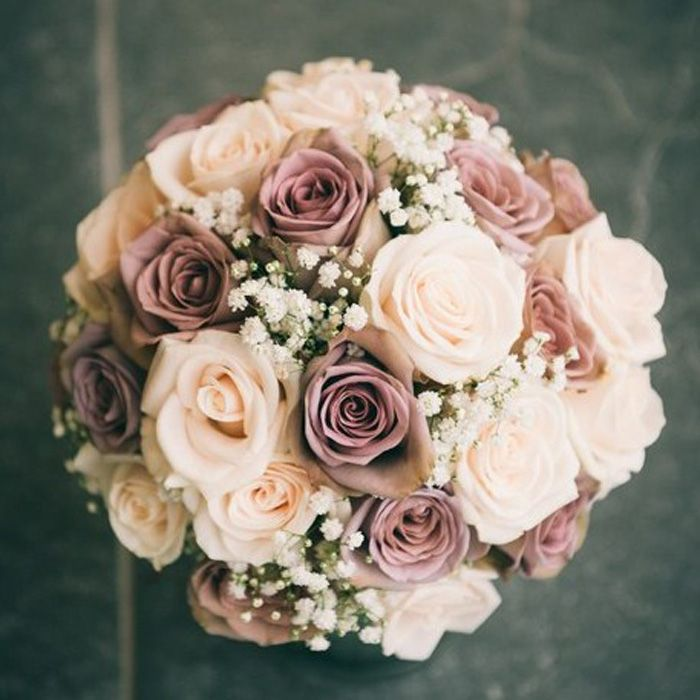 Carol - Hannah loves this bouquet.  It has the amnesia roses, quicksand, and I guess white or off white.  Since her dress is white, I would probably go with white.  But she would also love dusty miller around the perimeter if it doesn't get too wimpy.