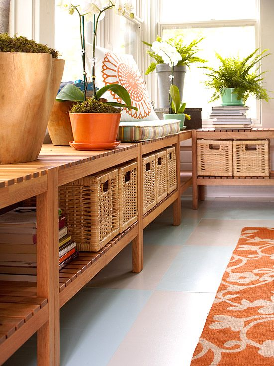 Versatile Benches: Wooden benches line the walls of the sunroom, creating additional seating, display, and storage space. The affordable wooden benches boast the look of built-ins yet they're completely movable. Pullout wicker baskets organize games, entertaining supplies, summer reading, and more.