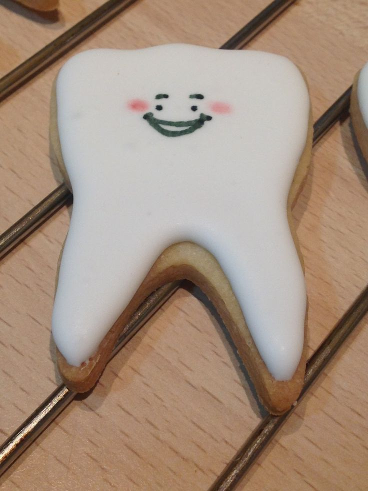 Tooth sugar cookies with cherry flavour icing.