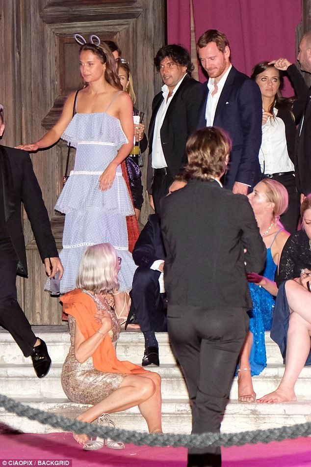 Let's party:Alicia Vikander and her boyfriend of three years Michael Fassbender were the picture of happiness as they left a party together in Venice, Italy on Friday