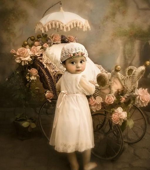SWEET LITTLE GIRL WITH FANCY BUGGY AND DOLL.
