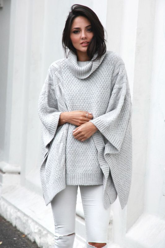 bells out roll neck poncho by Madison Square