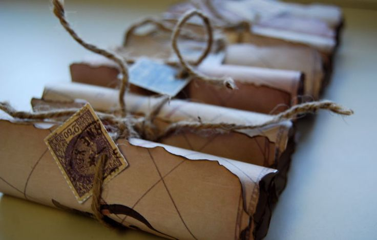 Think I'll make my own invites, roll them up, tie with string & personally deliver to our friends :)