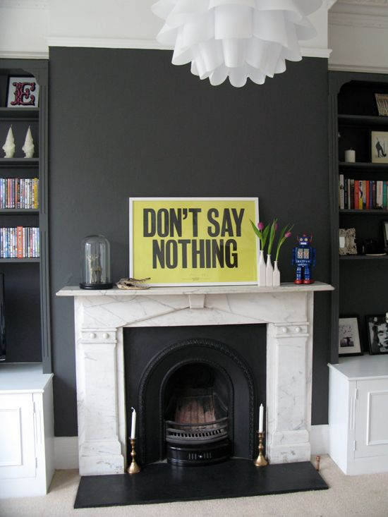 Dark grey walls / Victorian fireplace / yellow artwork