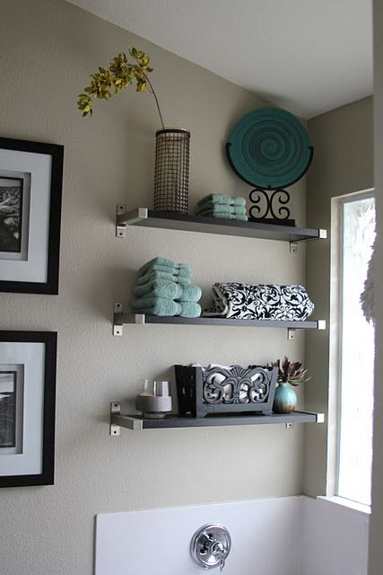 black and white bathroom with teal accent color. Use in upstairs bath with black and white pictures on small wall to bathroom.