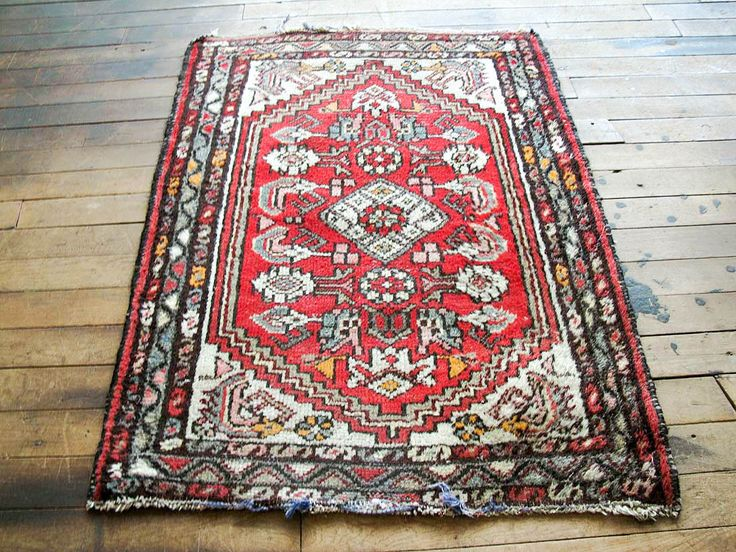 This is Celeste. She's a cute, modern styled vintage red Persian rug. If you've been hunting for a unique vintage Persian bedside rug, kitchen rug, or bathroom rug with the distressed bohemian rug loo
