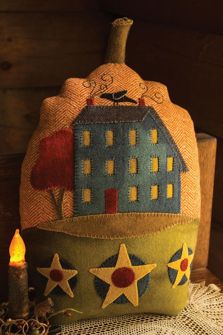 """<em>Autumn Glory, 9"""" x 14"""", flannel with wool appliqué. Designed and crafted by Punkin Patch Craft Designs, Granbury, Texas, 2015.</em><br /> <br /> Autumn has long been our favorite season of the year. It is the bounty of the harvest, the cooler weather, and the changing colors of the landscape that we love so much. The crisp fall air allows us to enjoy evenings full of handwork and creativity by the fire.<br /> <br /&g..."""