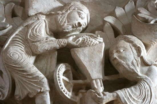 Moses milling the Law into the hands of Paul, Capital, Vezelay, France, c. 1120 - 1132.