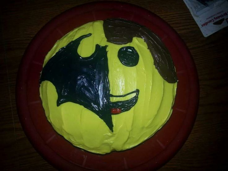 Jackson's 12th & Kegan's 7th combined birthdays. Batman and Lego Movie. Chocolate layer cake with milk chocolate icing in between layers covered in vanilla icing tinted yellow/black/brown/red to combine Batmans logo and Lego Emmit's face