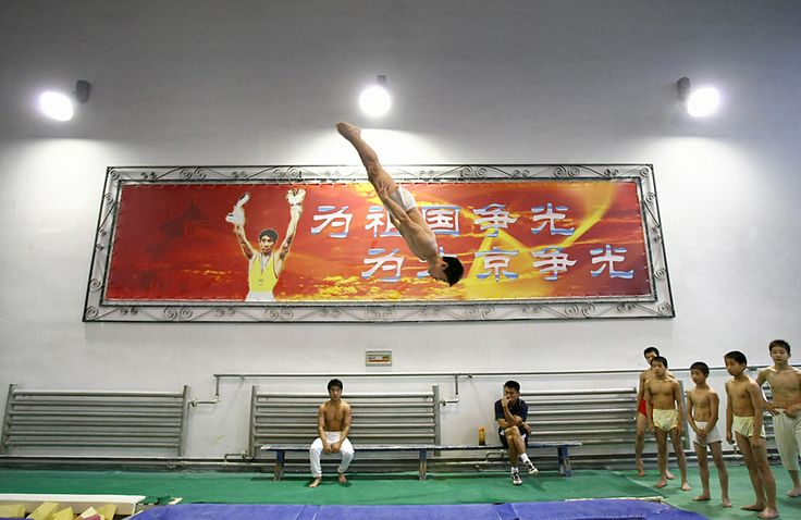 August 21, 2008 Pictures of the Day - Photo Journal - WSJ Young Chinese gymnasts train at Xiannongtan Sports School Thursday in Beijing. The school has been one of the cradles for China's champion athletes.