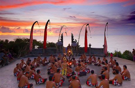 """Kecak Dance or Kecak Dance Arts is a dance originating from Bali Indonesia, Kecak Dance is performed by many [dozens or more] of the male dancers who are sitting in rows in a circle and with a certain rhythm and chanting """"cak"""" and raised his arm."""