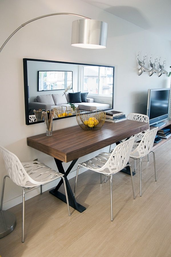 small dining area - mirror to make it look bigger - i also like the idea of facing chairs towards wall to separate the space