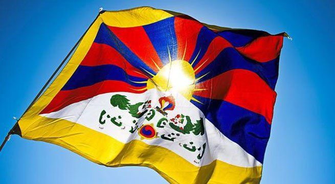 """Beijing: Chinese media is criticizing a reported move by the Tibetan government in exile to unfurl a flag representing its idea of """"Tibetan national flag"""" on the shores of Bangong Lake, known as Pangong Lake in India, in Ladakh. The lake is near the actual line of control between..."""