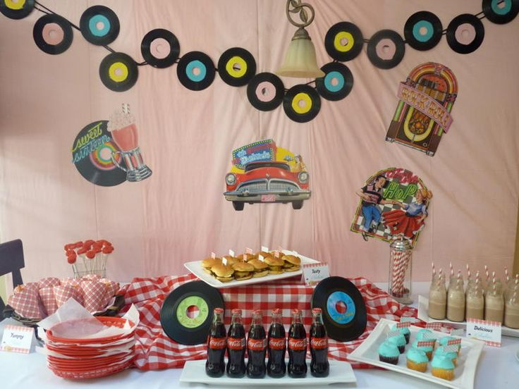 Erin of Catering By Erin McMahon contacted me and wanted to do a picnic style party with milkshakes and sliders for her daughter's 11th birthday. I thought it would be cute to add a fun 50's theme and decorate with records. We still stayed with the traditional red and white checker pattern of a picnic