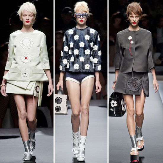 Prada Spring 2013. Graphic, neutral with pops of red. Embellished eyewear. 60s daisy prints.