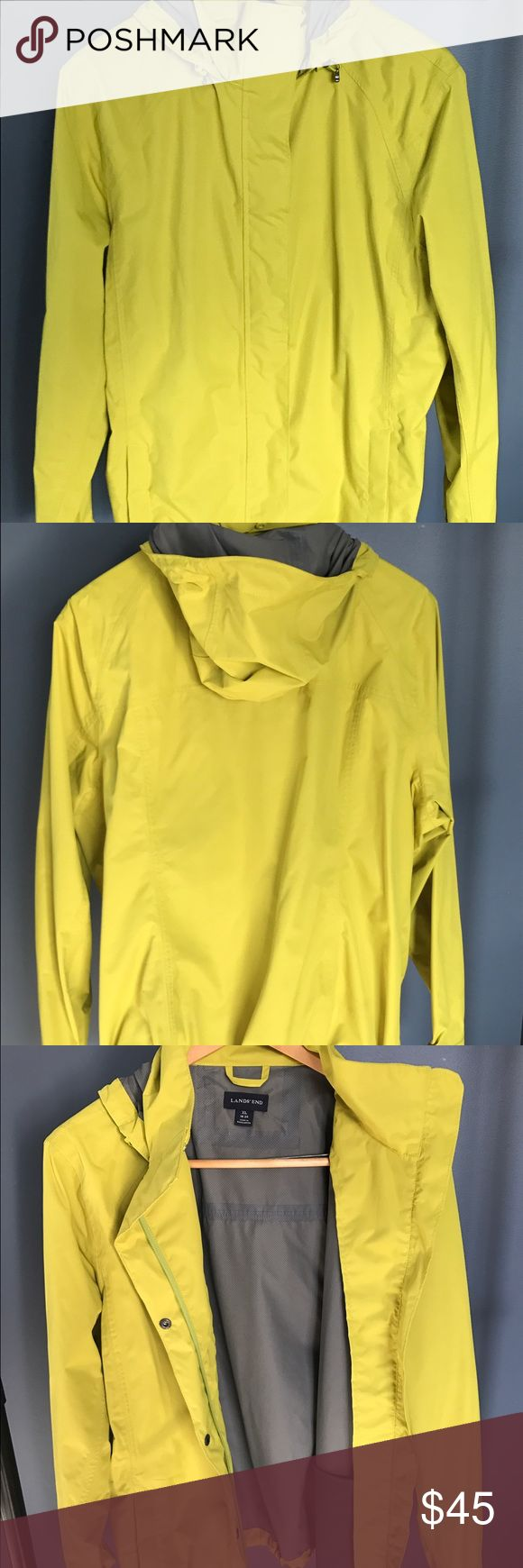 "Women's Lands End hooded rain coat. Size XL 18-30 Lands End rain jacket. Women XL 18-20. Has hood which can be rolled up & snapped into collar, zips & snaps up front, 2 front zip pockets. 2 inside mesh pockets, draw cords on each side of waist for perfect fit & to keep dry Distinctive color-hard to describe-a dusky pea green. I bought this for a trip to Disney, it stood out so my kids could easily find me in crowds- worked perfect! I've since ""under grown"" it. 28 in from bottom of collar to…"