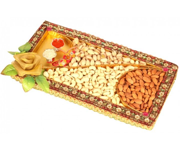 A beautiful Red Tray decorated with flowers containing best of almonds, cashews and raisons (125 gms each). T (Net Weight: 350 gms)